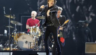 FILE - This Feb. 26, 2014 file photo shows Mick Jagger and the Rolling Stones performing during their concert at Tokyo Dome in Tokyo. The Rolling Stones said Tuesday April 1, 2014 they are resuming a world tour after postponing several dates in the wake of the death of L'Wren Scott, girlfriend of singer Mick Jagger. The band has announced new shows in Europe, starting May 26 in Oslo, Norway. (AP Photo/Shizuo Kambayashi, File)