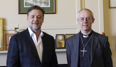 Photo issued by Lambeth Palace, showing the Archbishop of Canterbury Justin Welby as he meets with New Zealand actor Russell Crowe to discuss faith and spirituality at Lambeth Palace in London Tuesday April 1, 2014.  Even though Crowe's new film has prompted anger and cries of blasphemy from some religious groups, Welby held a short private meeting with Crowe, who is in London to promote his new movie based on the biblical story of Noah. (AP Photo / Lambeth Palace)