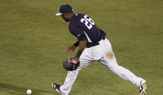In this photo taken on March 28, 2014, New York Yankees shortstop Eduardo Nunez chases down a ball hit by Miami Marlins' Jarrod Saltalamacchia during the ninth inning of a spring exhibition baseball game in Tampa, Fla. Nunez was charged with an error on the play. Yankees manager Joe Girardi announced Saturday, March, 29, that Yangervis Solarte beat out Nunez for a backup infield job. Nunez, who played in 90 games for the Yankees last year, was optioned to Triple-A Scranton/Wilkes-Barre. (AP Photo/Kathy Willens)