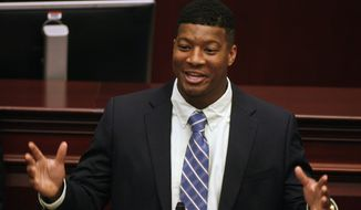 Florida State quarterback and 2013 Heisman Trophy winner Jameis Winston speaks Tuesday April 1, 2014 on the floor of the House of Representatives in Tallahassee, Fla. The Florida legislature honored the football team during Florida State Day at the Capitol for winning the BCS National Championship last January. (AP Photo/Phil Sears)
