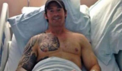 Fromer Navy SEAL Christopher Mark Heben recovers in a hospital after being shot in the stomach by assailants in Ohio. (Image: Facebook)