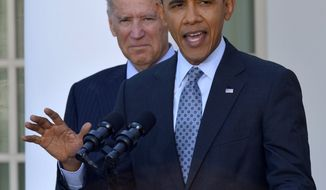 President Barack Obama, with Vice President Joe Biden, makes a statement on the Affordable Care Act, Tuesday, April 1, 2014, in the Rose Garden of the White House in Washington. (AP Photo/Susan Walsh)