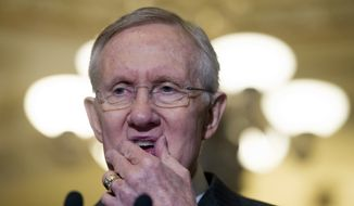 Senate Majority Leader Harry Reid of Nev. pauses while speaking with reporters on Capitol Hill in Washington, Tuesday, April 1, 2014, following a Senate Policy Luncheon. (AP Photo/Cliff Owen)