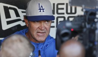 Los Angeles Dodgers manager Don Mattingly talks about his team during the managers dugout press conference prior  to an MLB Naational League baseball game against the San Diego Padres Wednesday, April 2, 2014, in San Diego.  (AP Photo/Lenny Ignelzi)