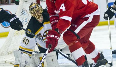 Detroit Red Wings forward Todd Bertuzzi (44) reaches for the puck in front of Boston Bruins goalie Tuukka Rask (40), of Finland, during the second period of an NHL hockey game in Detroit, Mich., Wednesday, April 2, 2014. (AP Photo/Tony Ding)