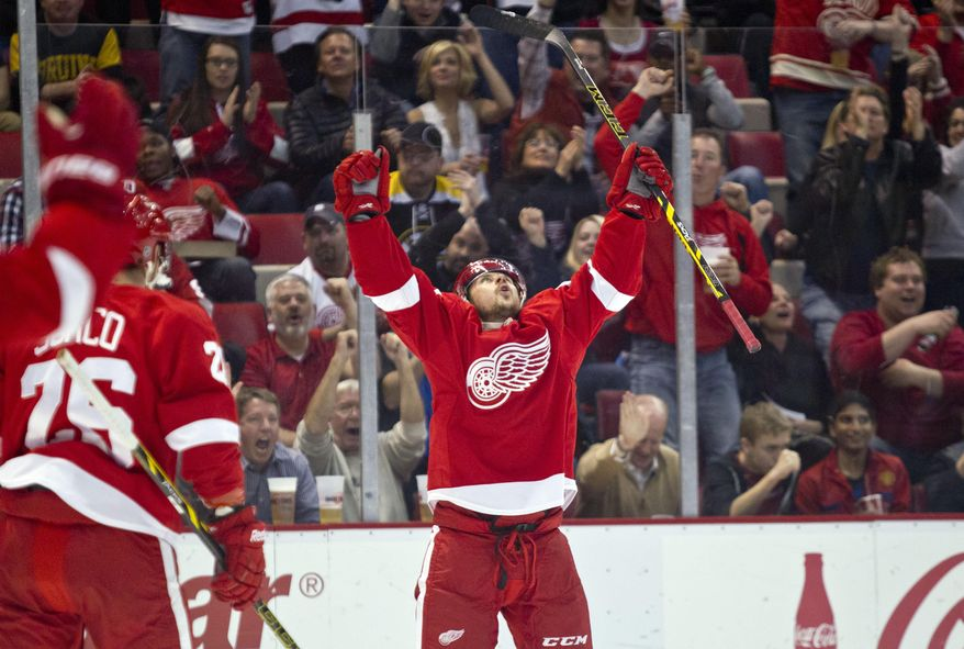 Detroit Red Wings forward Tomas Tatar celebrates his goal during the second period of an NHL hockey game against the Boston Bruins in Detroit, Mich., Wednesday, April 2, 2014. (AP Photo/Tony Ding)