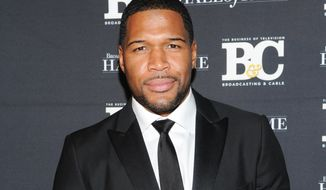 "** FILE ** This Oct. 28, 2013, file photo shows former professional football player Michael Strahan, co-host of ""Live with Kelly and Michael"" attending the 23rd Annual Broadcasting Cable Hall of Fame Awards in New York. (Photo by Evan Agostini/Invision/AP, File)"