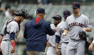 Cleveland Indians' Corey Kluber, right, hands the ball to manager Terry Francona as he is removed from the baseball game against the Oakland Athletics in the fourth inning Wednesday, April 2, 2014, in Oakland, Calif. (AP Photo/Ben Margot)