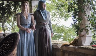 "This image released by HBO shows Natalie Dormer, left, and Diana Rigg in a scene from ""Game of Thrones."" The fourth season premieres Sunday at 9p.m. EST on HBO. (AP Photo/HBO, Macall B. Polay)"