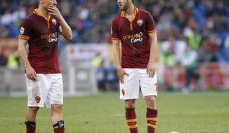 Roma midfielder Miralem Pjanic, of Bosnia, right, talks to teammate Francesco Totti, left, during a Serie A soccer match between Roma and Parma, at Rome's Olympic stadium, Wednesday, April 2, 2014. (AP Photo/Riccardo De Luca)