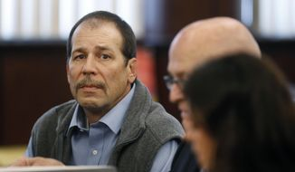 FILE - In a Dec. 18, 2013 file photo, Theodore Wafer, left, listens to his attorneys while appearing at his preliminary examination in district court in  in Dearborn Heights, Mich. The 55-year-old awaits trial on second-degree murder charges for fatally shooting  a young, unarmed woman through the screen door on his front porch. His lawyers are seeking to have the Wayne County Circuit Court trial judge take herself off the case because of her ties to prosecutors. A hearing is scheduled Friday, April 4, 2014. Defense attorneys say he feared for his life, but prosecutors say the shooting of Renisha McBride, 19, was not justified. (AP Photo/Paul Sancya)