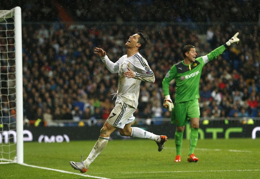 Real's Cristiano Ronaldo reacts after failing to score as Dortmund goalkeeper Roman Weidenfeller, right, argues with his teammates during a Champions League quarterfinal first leg soccer match between Real Madrid and Borussia Dortmund at the Santiago Bernabeu   stadium in Madrid, Spain, Wednesday, April 2, 2014. (AP Photo/Andres Kudacki)