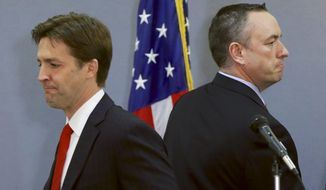 In this March 11, 2014, photo Republican-backed Senate candidate Shane Osborn, right, and tea-party backed Ben Sasse, left, leave the stage after a debate in Omaha, Neb. (AP Photo/Nati Harnik)