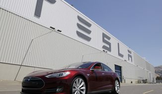 FILE - This June 22, 2012 file photo shows a Tesla Model S driving outside the Tesla factory in Fremont, Calif. Electric-car company Tesla Motors has filed notice it intends to sue New Jersey over a ruling that would stop it from selling its vehicles in the state within two weeks. Palo Alto, Calif.-based Tesla claims it was unfairly targeted in March 2014 when the state Motor Vehicle Commission amended its regulations. The regulations require new-car dealers to have franchise agreements before they can be licensed. That prohibits companies from using a direct-sales model as Tesla does. (AP Photo/Paul Sakuma, File)