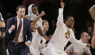 Minnesota head coach Richard Pitino reacts with his team during the first half of an NCAA college basketball game against Florida State Seminoles in the semifinals of the NIT Tuesday, April 1, 2014, in New York. (AP Photo/Frank Franklin II)