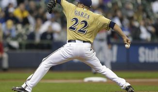 Milwaukee Brewers starting pitcher Matt Garza throws to the Atlanta Braves during the third inning of a baseball game Wednesday, April 2, 2014, in Milwaukee. (AP Photo/Jeffrey Phelps)