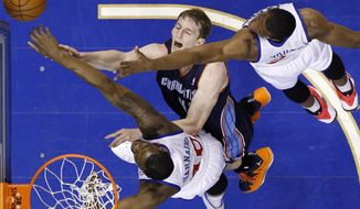Charlotte Bobcats' Cody Zeller, center, has his shot blocked by Philadelphia 76ers' Jarvis Varnado, bottom, and Thaddeus Young during the first half of an NBA basketball game, Wednesday, April 2, 2014, in Philadelphia. (AP Photo/Matt Slocum)