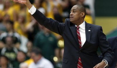 Fresno State coach Rodney Terry signals to players during the first half of a College Basketball Invitational championship series game against Siena on Wednesday, April 2, 2014, in Loudonville, N.Y. (AP Photo/Mike Groll)
