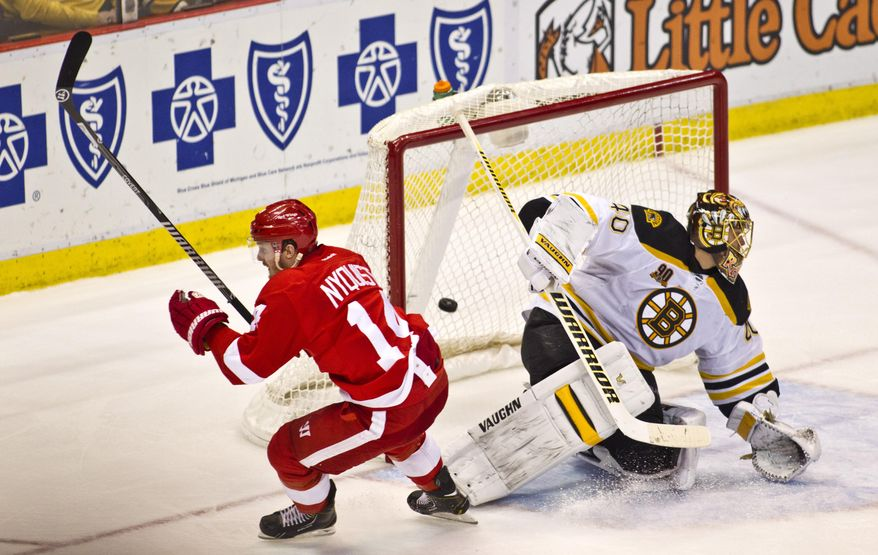 Detroit Red Wings forward Gustav Nyquist (14) scores the game-winning goal against Boston Bruins goalie Tuukka Rask (40), of Finland, during the third period of an NHL hockey game in Detroit, Mich., Wednesday, April 2, 2014. The Red Wings won 3-2. (AP Photo/Tony Ding)