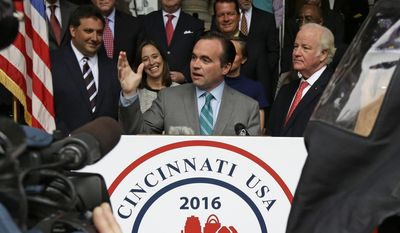 Cincinnati Mayor John Cranley, center, and John Barrett, right, president and chief operation officer of Western & Southern Financial Group. speak at a news conference, Wednesday, April 2, 2014, in Cincinnati, where Cincinnati was announced as one of six candidates to host the 2016 Republican national convention. (AP Photo/Al Behrman)