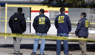 FILE - In this Jan. 31, 2013, file photo, ATF agents stand close to the area where  Kaufman County Assistant District Attorney Mark Hasse was shot and killed as he was walking from his car to the courthouse in downtown Kaufman, Texas. A dive team has recovered a weapon from a North Texas lake that authorities say was used in the fatal shooting of Hasse, authorities said Wednesday, April 2, 2104.(AP Photo/The Dallas Morning News, David Woo, File) MANDATORY CREDIT; MAGS OUT; TV OUT; INTERNET USE BY AP MEMBERS ONLY; NO SALES