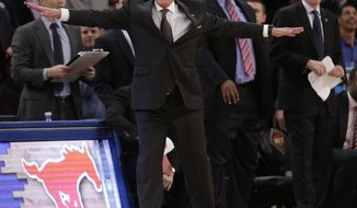 SMU head coach Larry Brown calls out to his team during the second half of an NCAA college basketball game against Clemson in the semifinals of the NIT Tuesday, April 1, 2014, in New York. SMU won the game 65-59. (AP Photo/Frank Franklin II)
