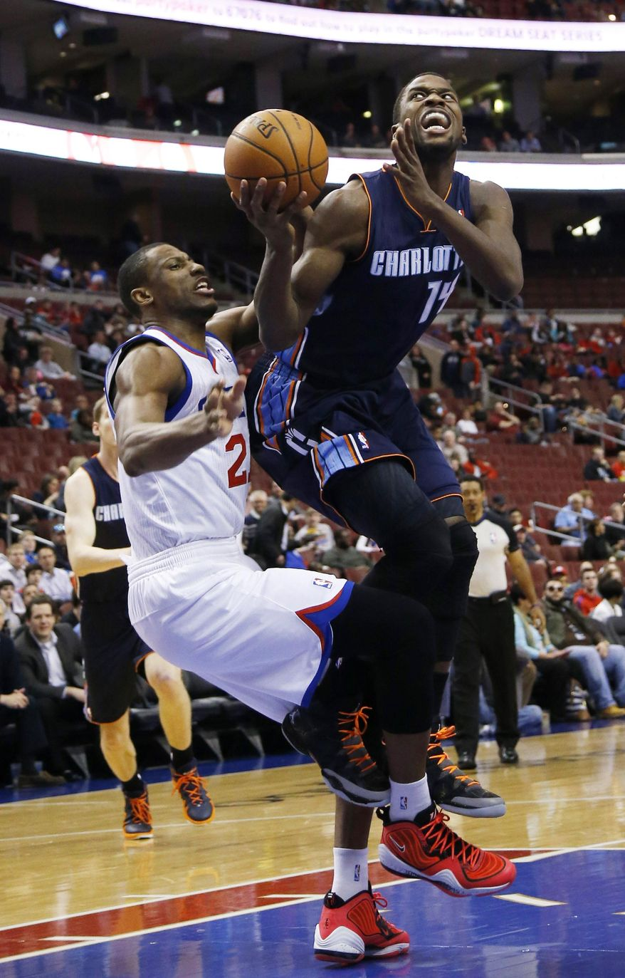 Charlotte Bobcats' Michael Kidd-Gilchrist, right, goes up for a shot after a foul by Philadelphia 76ers' Thaddeus Young during the first half of an NBA basketball game, Wednesday, April 2, 2014, in Philadelphia. (AP Photo/Matt Slocum)