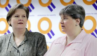 FILE - In this March 17, 2014 file photo, Mary Bishop, left, listens as her partner Sharon Baldwin speaks about the status of appeals in the ongoing Oklahoma same sex marriage fight during a news conference at the Dennis R. Neill Equality Center in Tulsa, Okla. In a brief filed Tuesday, April 1, 2014, lawyers for an Oklahoma clerk who refused to grant a marriage license to Bishop and Baldwin say marriage exists for its procreative potential and that the U.S. Supreme Court agrees. (AP Photo/Tulsa World, Michael Wyke, File) ONLINE OUT; KOTV OUT; KJRH OUT; KTUL OUT; KOKI OUT; KQCW OUT; KDOR OUT; TULSA OUT; TULSA ONLINE OUT