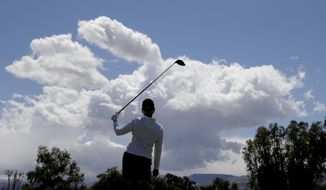 Karrie Webb, of Australia, watches her tee shot on the 11th hole during the pro-am at the LPGA Kraft Nabisco Championship golf tournament on Wednesday, April 2, 2014 in Rancho Mirage, Calif. (AP Photo/Chris Carlson)