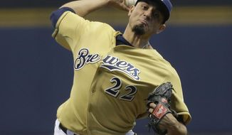 Milwaukee Brewers starting pitcher Matt Garza throws to the Atlanta Braves during the first inning of a baseball game Wednesday, April 2, 2014, in Milwaukee. (AP Photo/Jeffrey Phelps)