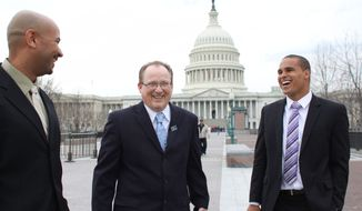 From left, former Northwestern University football quarterback Kain Colter, Ramogi Huma, founder and President of the National College Players Association and Tim Waters, Political Director of the United Steel Workers, arrive on Capitol Hill in Wednesday, April, 2, 2014. Members of a group seeking to unionize college athletes are looking for allies on Capitol Hill as they brace for an appeal of a ruling that said full scholarship athletes at Northwestern University are employees who have the right to form a union. Former Northwestern quarterback Kain Colter _ the face of a movement to give college athletes the right to unionize _ and Ramogi Huma, the founder and president of the National College Players Association, scheduled meetings Wednesday with lawmakers. (AP Photo/Lauren Victoria Burke)