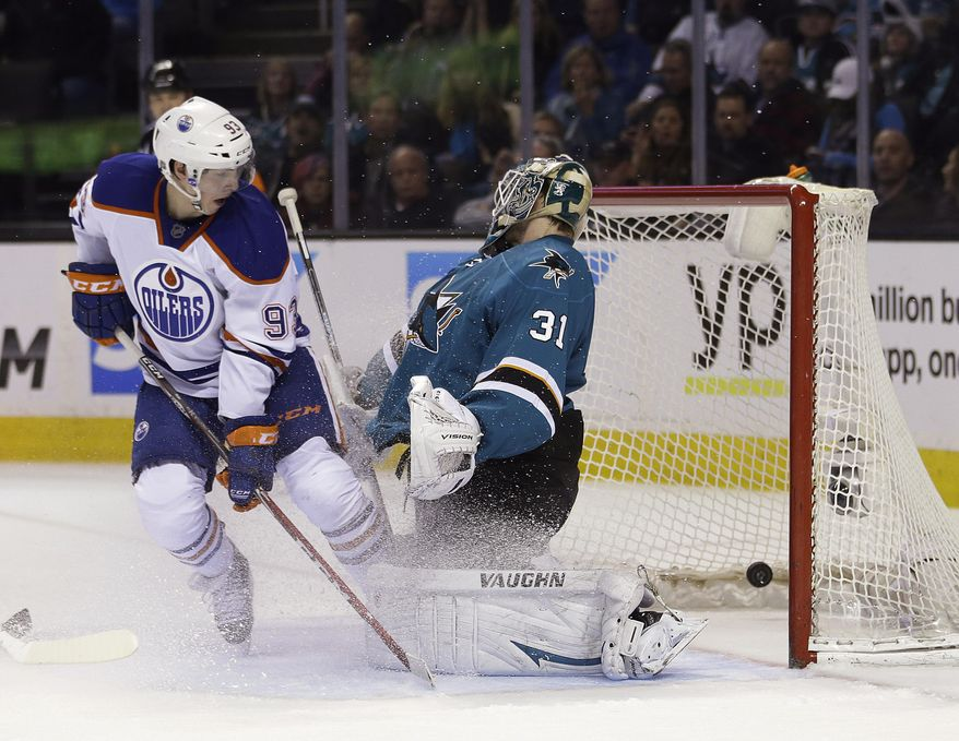 Edmonton Oilers center Ryan Nugent-Hopkins (93) scores a goal past San Jose Sharks goalie Antti Niemi (31), of Finland, during the second period of an NHL hockey game Tuesday, April 1, 2014, in San Jose, Calif. (AP Photo/Tony Avelar)