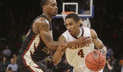 Minnesota's Deandre Mathieu (4) drives past Florida State Seminoles's Aaron Thomas (25) during the first half of an NCAA college basketball game in the semifinals of the NIT Tuesday, April 1, 2014, in New York. (AP Photo/Frank Franklin II)