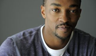 """In this Wednesday, March 12, 2014 photo, Anthony Mackie, a cast member in """"Captain America: The Winter Soldier,"""" poses for a portrait in Beverly Hills, Calif.  Mackie plays the role of Falcon in the Marvel/Disney movie which releases on Friday, April 4, 2014. Being the character of Falcon was """"monumental"""" to the actor. (Photo by Chris Pizzello/Invision/AP)"""