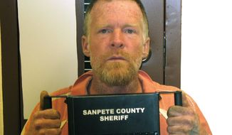 """FILE - This photo released by the Sanpete County Sheriff's Office shows Troy James Knapp.  Knapp, a backwoods recluse accused of burglarizing a string of cabins in remote areas of Utah is facing new burglary charges in a seventh county. Prosecutors in central Utah's Sevier County filed four charges of aggravated burglary and theft on Monday, March 31, 2014, against the 46-year-old Knapp, known as the """"Mountain Man.""""  He is now facing more than 40 charges in seven counties after officials say he lived in and ransacked remote cabins across Utah for years. He is accused shooting at a Utah Highway Patrol helicopter and aiming an assault rifle at other officers before surrendering in April 2013. Knapp is scheduled to take plea deal in federal court next week on federal firearm charges. The terms of the agreement are not disclosed, and federal prosecutors say no plea deal is finalized. (AP Photo/Sanpete County Sheriff's Office, File)"""