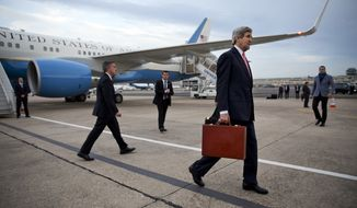 FILE - This March 29, 2014 file-pool photo shows Secretary of State John Kerry arriving in Paris. More than a week into what had been a scheduled five-day trip to Europe and Saudi Arabia, Kerry sat in a Paris hotel suite last Monday morning contemplating his next moves on multiple crisis fronts. Despite a hastily arranged emergency meeting with his Russian counterpart in the French capital the night before, Moscow was still massing troops on Ukraine's border, apparently threatening invasion, and Kerry's pet project, the Israeli-Palestinian peace process, was teetering on the brink of collapse. (AP Photo/Jacquelyn Martin, File-Pool)