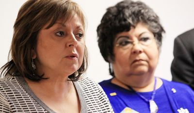 CORRECTS DAY OF WEEK TO WEDNESDAY, NOT MONDAY - Gov. Susana Martinez, left, and Children, Youth and Families Secretary Yolanda Deines answer questions about a series of initiatives aimed at improving New Mexico's child welfare system during a news conference in Albuquerque, N.M. on Tuesday, April 2, 2014. (AP Photo/Susan Montoya Bryan)