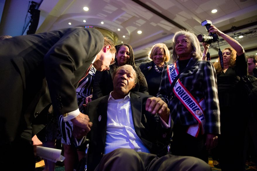 Washington, D.C. Mayor Vincent Gray, left, stops to speak to Councimembers Marion Barry (D-Ward 8), center, and Yvette Alexander (D-Ward 7), center right, as he arrives to deliver his concession speech on election night at the Hyatt Regency on Capitol Hill after losing to Muriel Bowser, Washington, D.C., Tuesday, April 1, 2014. (Andrew Harnik/The Washington Times)