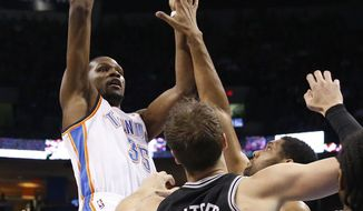 Oklahoma City Thunder forward Kevin Durant (35) shoots over San Antonio Spurs forward Tim Duncan, center Tiago Splitter (22) and forward Kawhi Leonard (2) during the first quarter of an NBA basketball game in Oklahoma City, Thursday, April 3, 2014. (AP Photo/Sue Ogrocki)