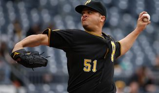 Pittsburgh Pirates starting pitcher Wandy Rodriguez delivers during the third inning of a baseball game against the Chicago Cubs in Pittsburgh Thursday, April 3, 2014. (AP Photo/Gene J. Puskar)