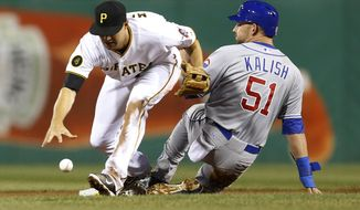 Pittsburgh Pirates shortstop Jordy Mercer, left, drops the ball and Chicago Cubs' Ryan Kalish (51) is safe at second on a ground ball by Edwin Jackson in the fifth inning of a baseball game Wednesday, April 2, 2014, in Pittsburgh. A throwing error was ruled on Pirates third baseman Pedro Alvarez. (AP Photo/Keith Srakocic)