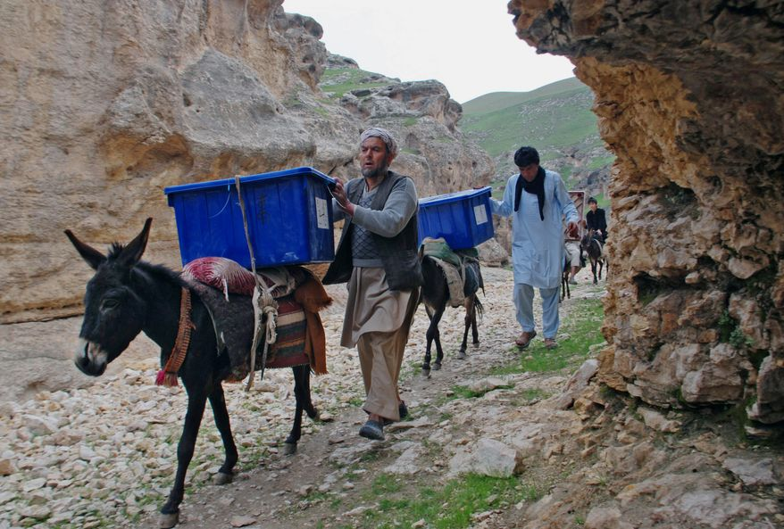 ON THE WAY: Afghan election workers use an age-old method to transport ballot boxes and election materials.