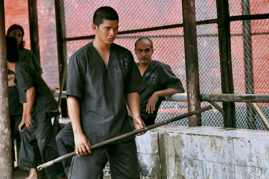 """Iko Uwais, a renowned champion in the Indonesian pencak silat fighting style, gets to stretch out as an actor in """"The Raid 2,"""" a film packed with intense action sequences. (Sony Pictures Classic via Associated Press)"""