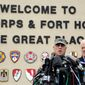 Lt. Gen. Mark Milley (left) and Sen. John Cornyn, Texas Republican, talk to the media near Fort Hood's main gate one day after a soldier opened fire on fellow service members at the Fort Hood military base, killing three people and wounding 16 before committing suicide. (Associated Press)