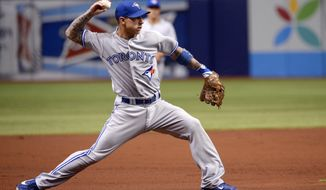 Toronto Blue Jays third baseman Brett Lawrie throws out Tampa Bay Rays' Desmond Jennings at first after fielding his grounder during the first inning of a baseball game in St. Petersburg, Fla., Thursday, April 3, 2014. (AP Photo/Phelan M. Ebenhack)