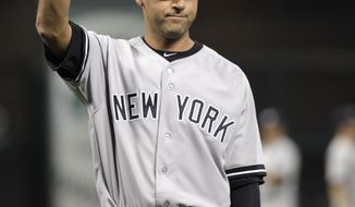 New York Yankees shortstop Derek Jeter waves to fans during a retirement ceremony before a baseball game against the Houston Astros, Wednesday, April 2, 2014, in Houston.  (AP Photo/Patric Schneider)