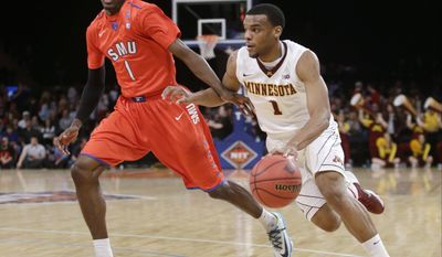 Minnesota's Andre Hollins (1) drives past SMU's Ryan Manuel (1) during the first half of an NCAA college basketball game in the final of the NIT, Thursday, April 3, 2014, in New York. (AP Photo/Frank Franklin II)