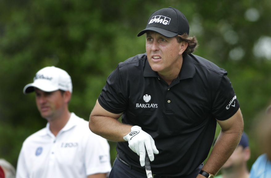 Phil Mickelson watches his drive on the fifth hole during the first round of the Shell Houston Open, Thursday, April 3, 2014, in Humble Texas. (AP Photo/Patric Schneider)