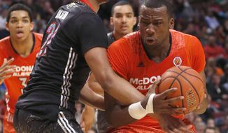 McDonald's West All-American Jahlil Okafor, left, fouls McDonald's East All-American Cliff Alexander during the second half of the McDonald's All-American boy's basketball game Wednesday, April 2, 2014, in Chicago . The West won 105-102. (AP Photo/Charles Rex Arbogast)