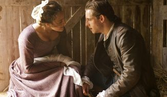 "This image released by AMC shows Heather Lind as Anna Strong, left, and Jamie Bell as Abe Woodhull in a scene from ""Turn,"" premiering Sunday at 9 p.m. EDT. (AP Photo/AMC, Antony Platt)"